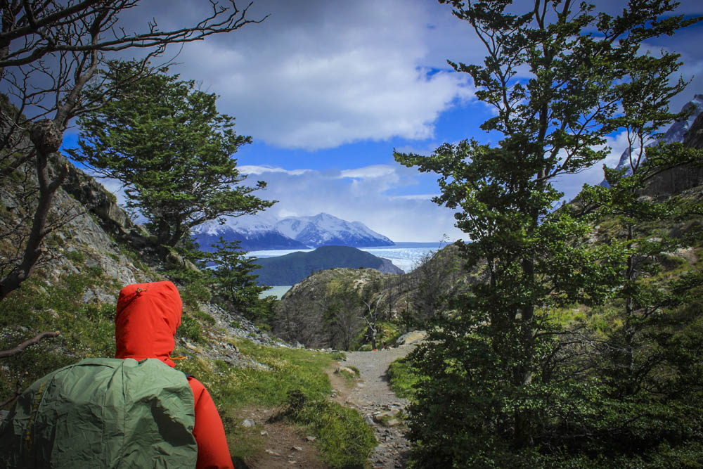 A traveller hikes toward Grey Glacier in Torres del Paine, Chile. With a total surface area of 270 square kilometres, it is an important attraction in Patagonia.