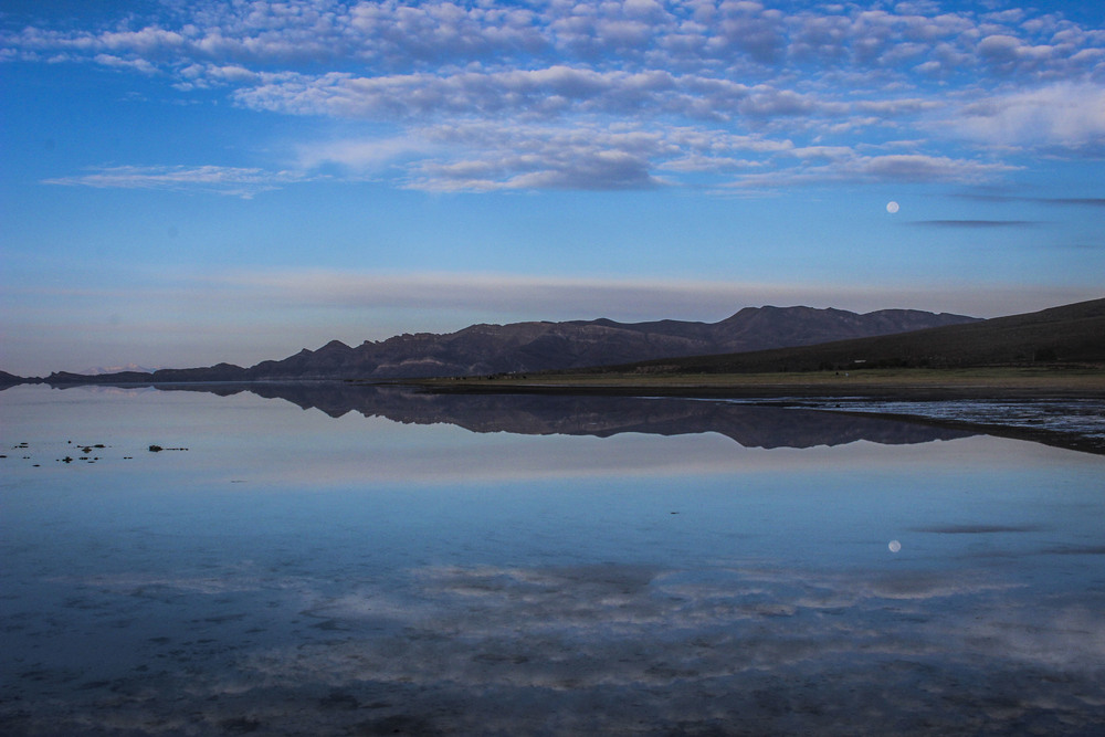 The famous mirror effect after a night of rain in the Salar de Uyuni, Bolivia.