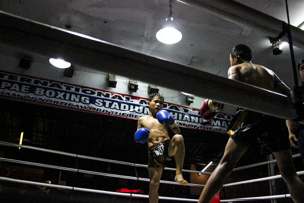 The young boy fights his opponent. Children train up to five days a week, their gyms becoming a second home.