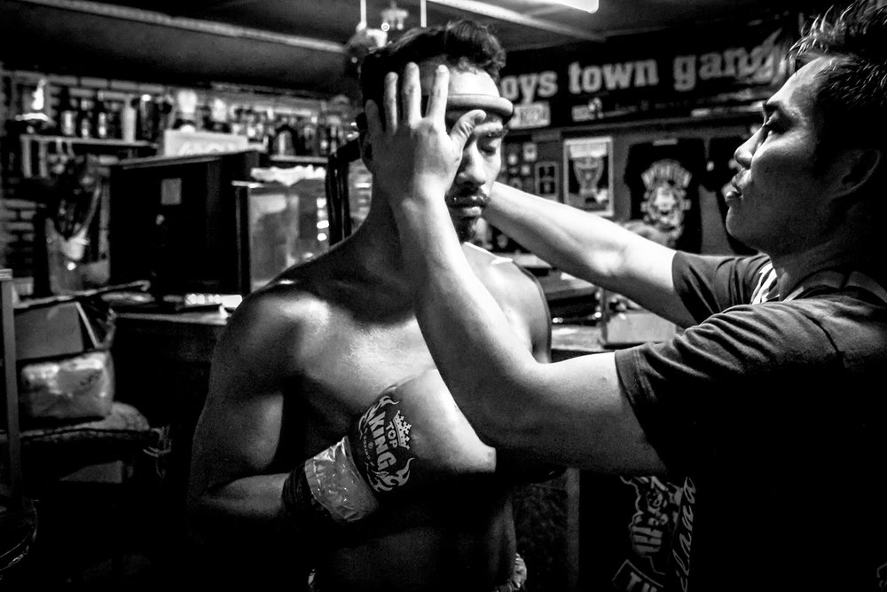 Richy Vischer prepares for his Muay Thai fight. He is being fitted with a traditional Mongkon/Mongkol.