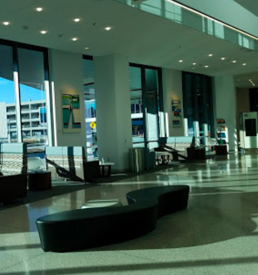 Image taken from the University of Kansas Medical Center website. Nine large paintings are between windows in the main lobby area of the Cambridge Tower.