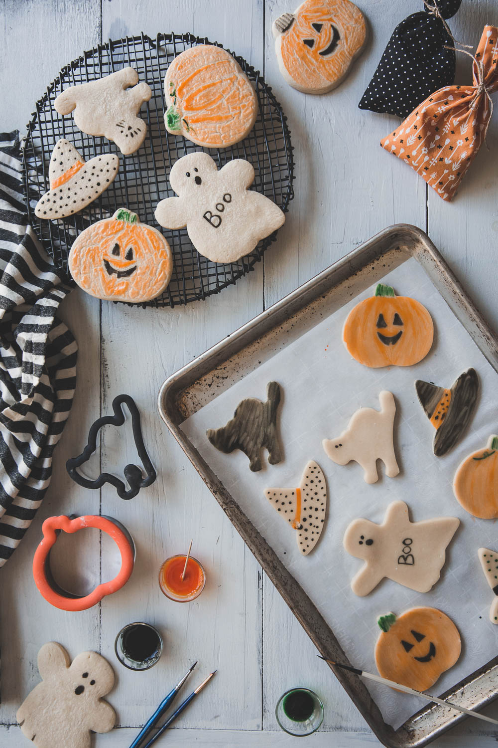 Before and after baking painted Halloween sugar cookies