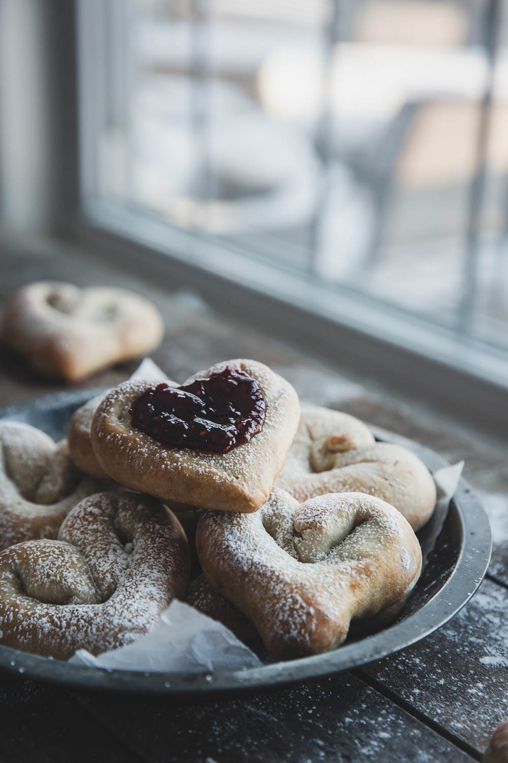 Raspberry jam on a heart-shaped cardamom bun