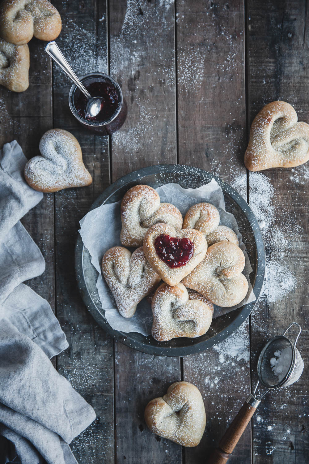 Sugar-dusted cardamom heart buns with raspberry jam
