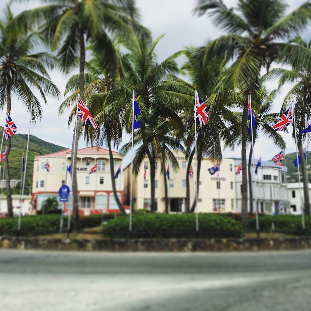 The venerable Union Jack intersperses the flag of the British Virgin Islands circling the roundabout in downtown Road Town, Tortola, BVI.