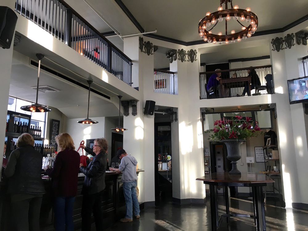 We love the vibe and eclectic urban styling in the two-level tasting room when you first walk through the door. Folks seem to enjoy themselves here!