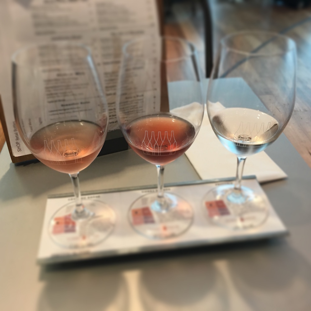 "The best way to learn is to try and compare different wines side by side at home with friends, at the winery, or at wine bars that specialize in ""flights"" as pictured here (a lineup of different yet related wines)."