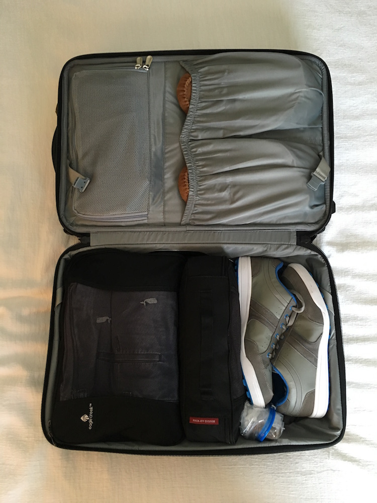 Use packing cubes to keep your casual clothes organized and compressed. Golf spikes or other athletic shoes will give you a little trouble, but as you can see here I've got them wedged in along with 5 days worth of other stuff.