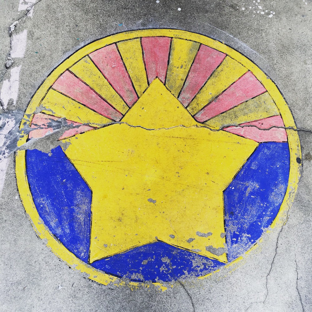 Tasting room visitors are greeted by this stylized image from the Arizona state flag painted on the sidewalk out front.