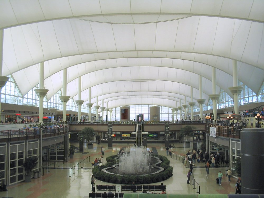 The unique main terminal at Denver (DEN) lets soft light inside and is styled after the snow-capped Rockies outside.
