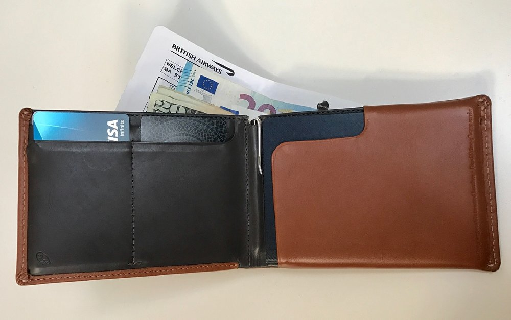 It all fits. Note the little silver pen clipped in the seam. The  Bellroy Leather Travel Wallet  is available in black, brown, or caramel (I chose caramel) coloring with or without RFID protection.