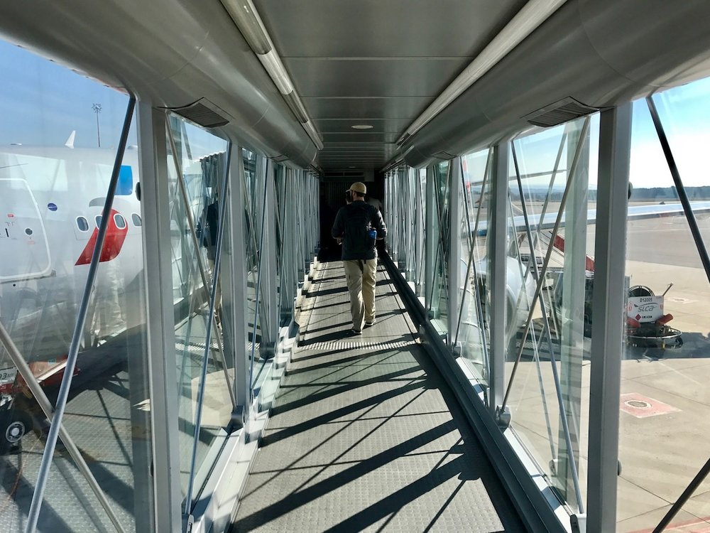Glass jet bridges on a sunny day always make me smile as I board the plane.