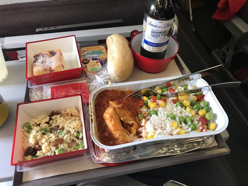 Chicken edition of one of the best economy class meals we've had in a long time. It doesn't beat the curry on British Airways, but the couscous on its own is delicious as airplane food goes.