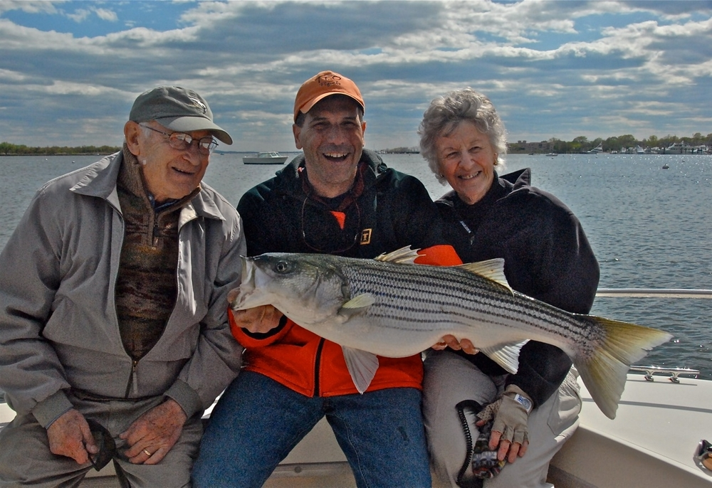 Joan Wulff with a 20 lb striper