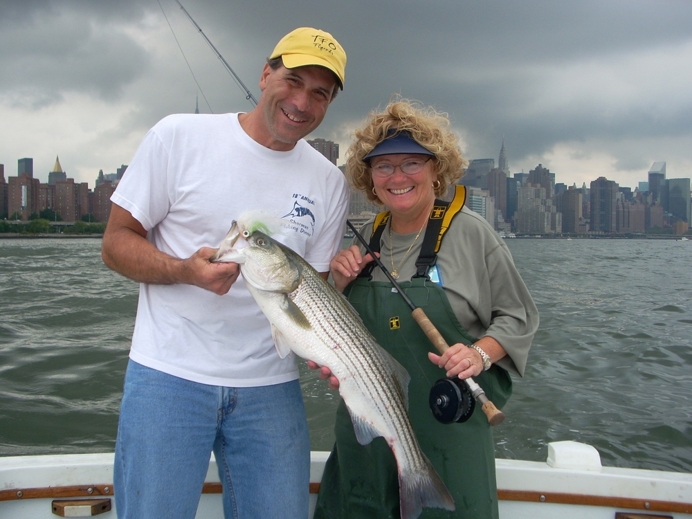 Captain Joan Sharrott with a striped bass