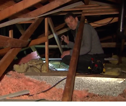 The Inspector Shawn Anderson inspecting a home attic.