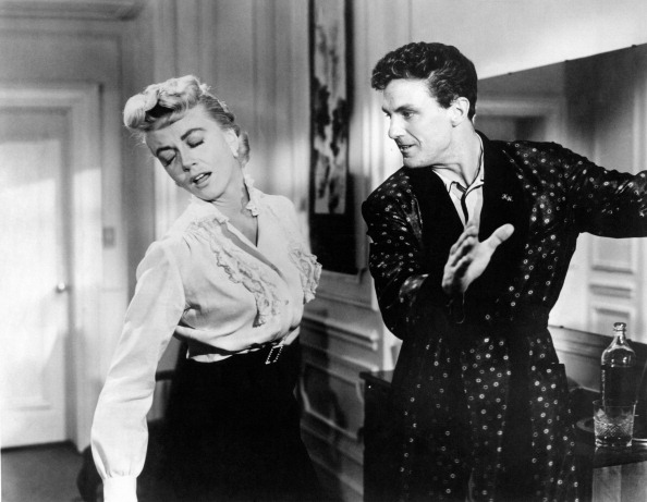 Dorothy Malone and Robert Stack have sibling rivalry in Written on the Wind (1956).
