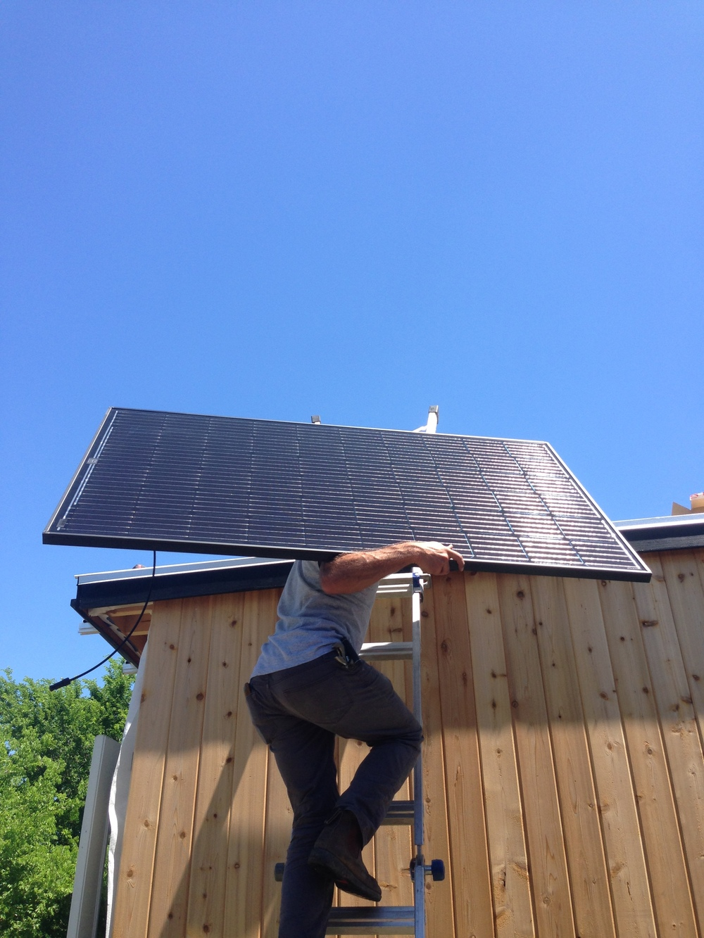 tiny-house-solar-panel-installation-earth-day-2016-2