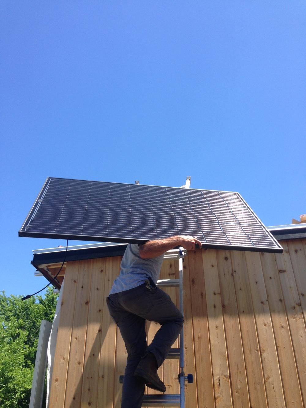 tiny-house-solar-panel-installation-earth-day-2016-2