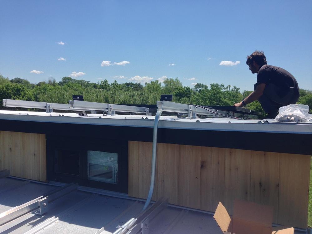 tiny-house-solar-panel-installation-earth-day11