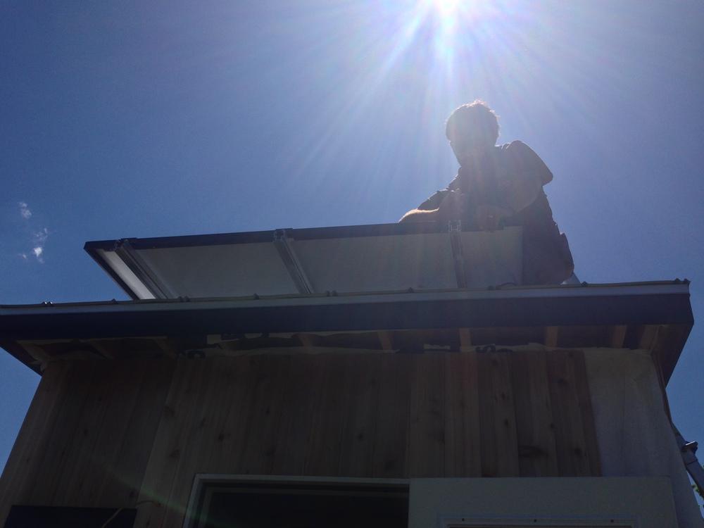 tiny-house-solar-panel-installation-earth-day10