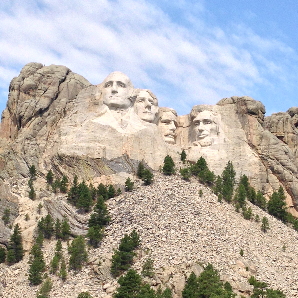 Left to right the heads of Washington, Jefferson, Roosevelt (Teddy), and Lincoln.