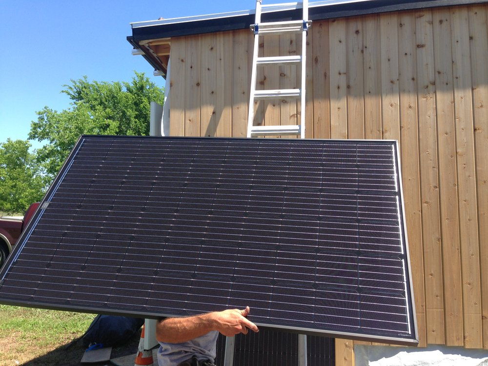 tiny-house-solar-panel-installation-earth-day-2016.JPG