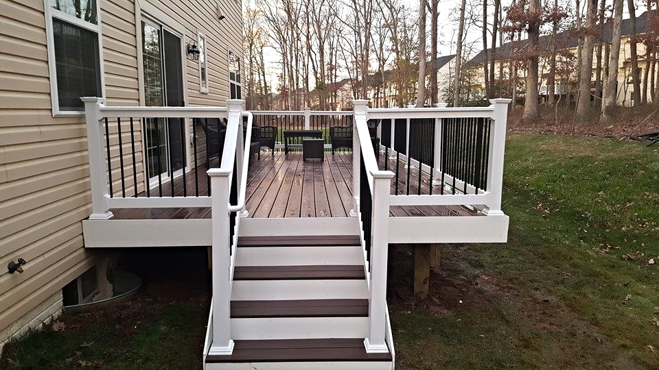 Rosewood Deck with White Railings and Black Balusters