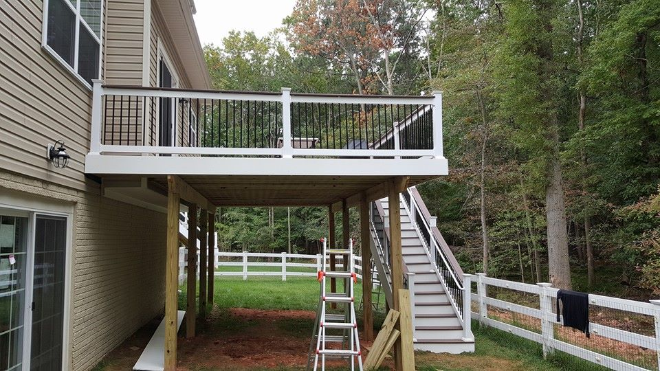Second Level deck with stairs Tudor Brown Decking, White Rails, Black balusters, White Fascia