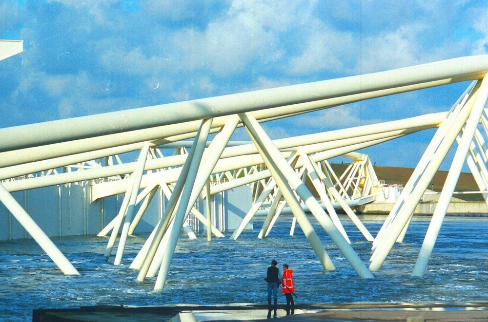 Photo of the Maeslantkering Storm Surge Barrier with river flooding: stock photo taken from Google