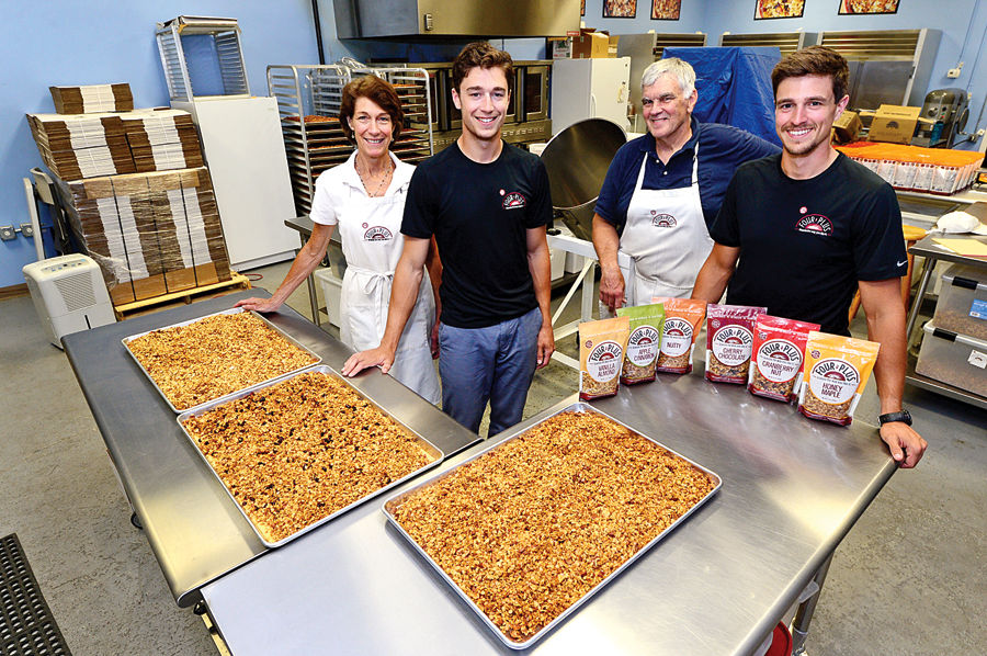 Cordy Kelly with her husband and her two sons, the Kelly family behind Kelly's Four Plus Granola.