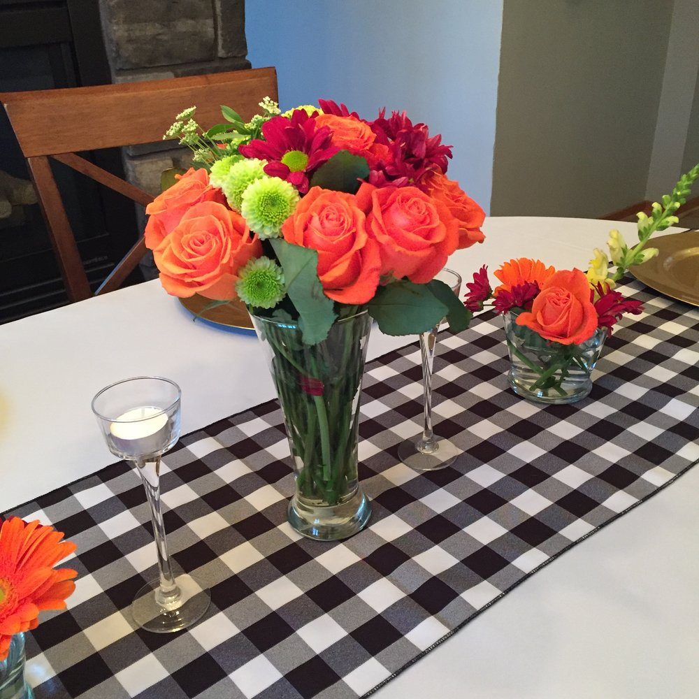 Grocery Store Floral - Purchased a single large bouquet of mixed blooms from the local grocery store and split it between a large taller vase and two smaller bud vases. Host time contribution: 15 minutes