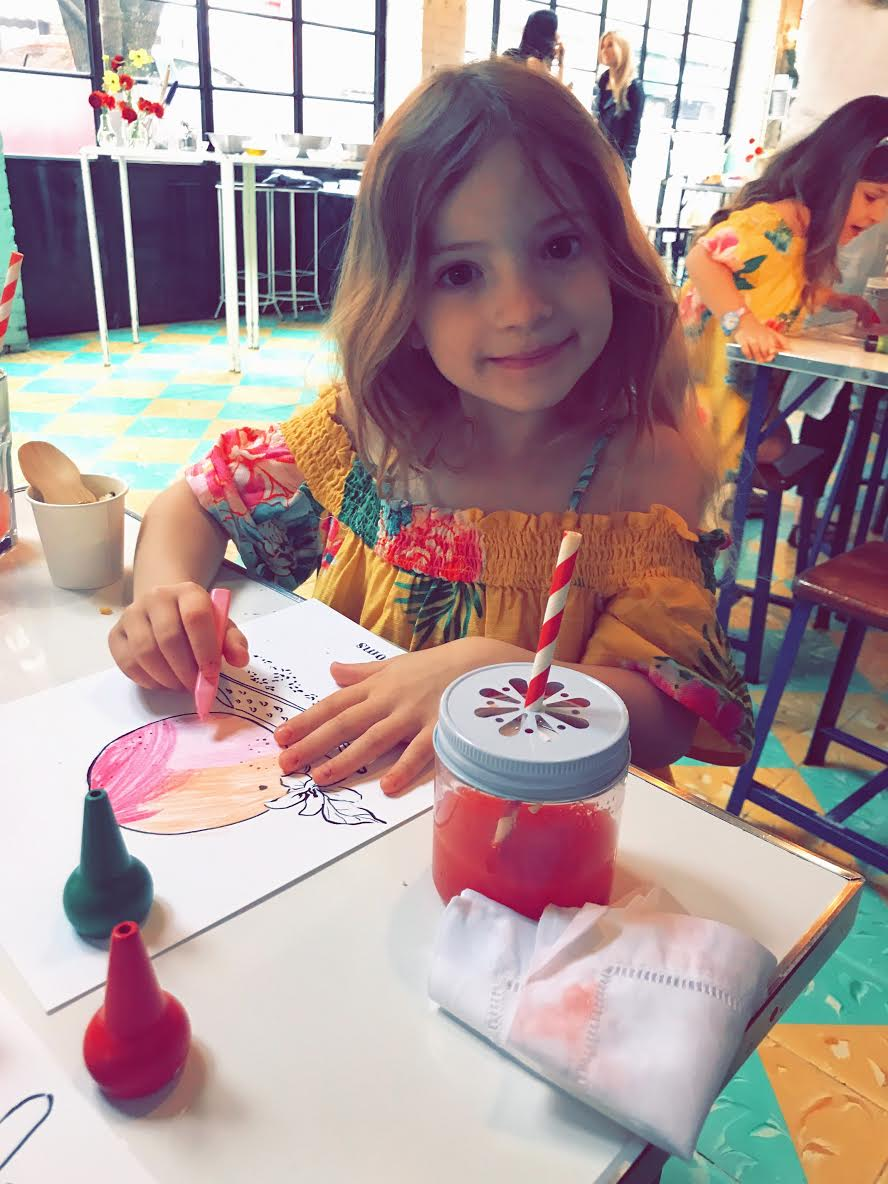Ph: Honor colouring and sipping on her festive and delicious watermelon juice -   at Tacombi