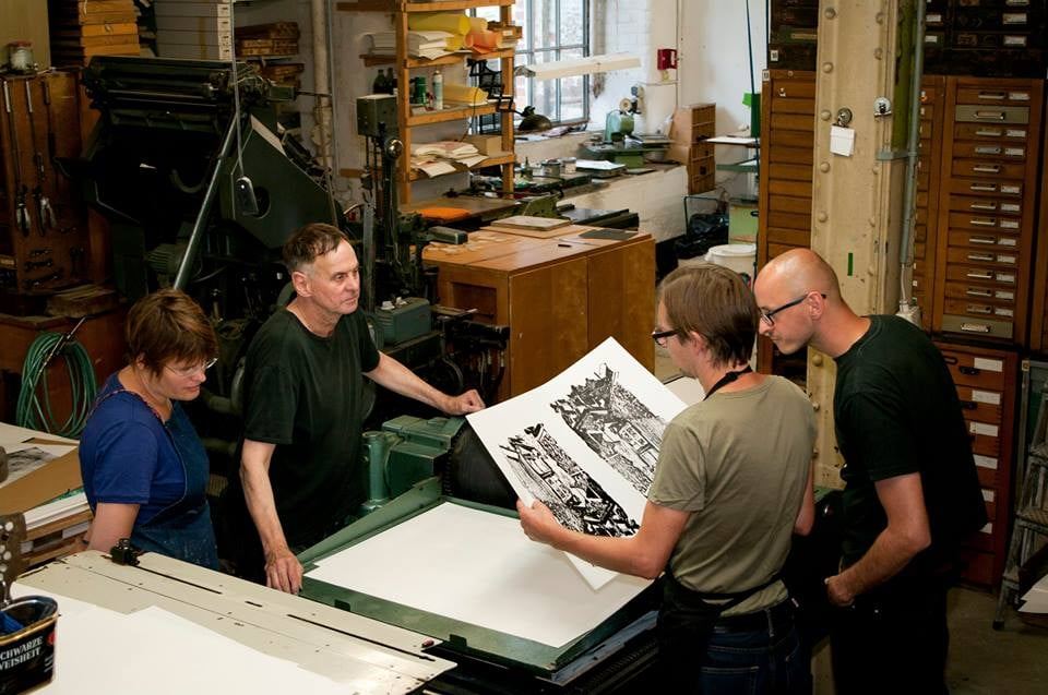 Every year master printer Thomas Siemon invites a small group of artists to execute projects in his workshop, carpe plumbum, as a part of the Hochdruck-Grafik-Symposium.  The artists from left to right are Sarah Pike, USA, Thomas P Konietschke, Eppertshausen, Germany, Thomas Siemon, Tino Geiss, Leipzig, Germany, and Benjamin Badock, Leipzig, Germany (absent).  Photo: carpe plumbum