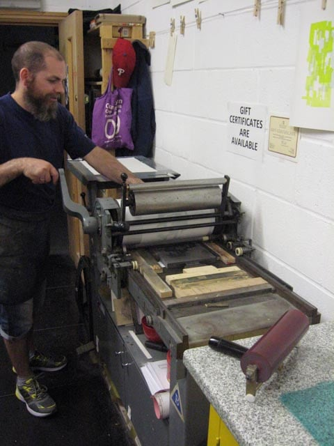 Master printer Lee Turner printing one of two relief prints published by Hole Editions, Newcastle, UK, 2015.