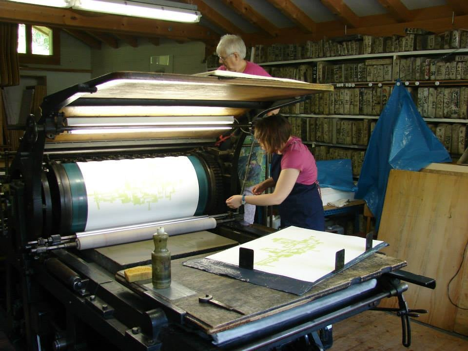 Printing on the Schnellpresse (fast press).  I love the sound and rhythmic workings of this press.   Ernst and Erica Hanke Steindruckerei, Ringgenberg, Switzerland, 2014.   Photo: Ernst Hanke