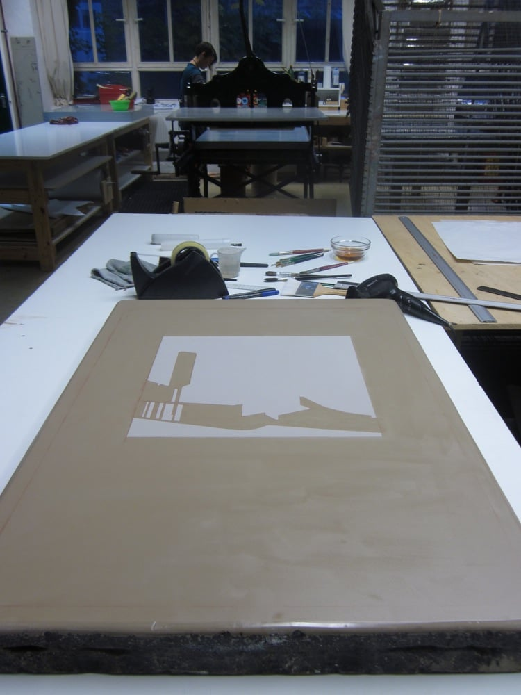 Preparing the stone for litho-aquatint with a drawing in gum Arabic.  Keystone Editions, Berlin, Germany, 2012.