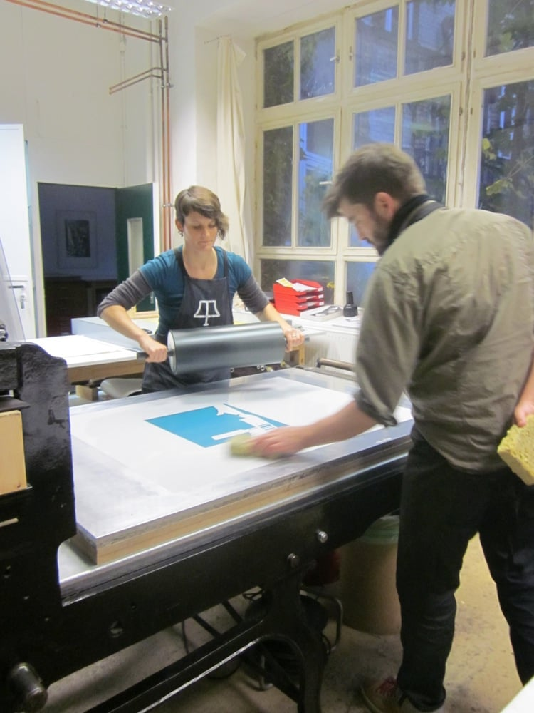 Master printers Sarah Dudley and Uli Kühle proofing photo-plate.  Keystone Editions, Berline, Germany, 2012