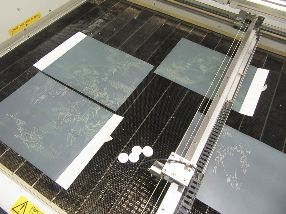 Working multiple laser engraved prints at a time.  Dundee Contemporary Arts, Dundee, Scotland, 2015.