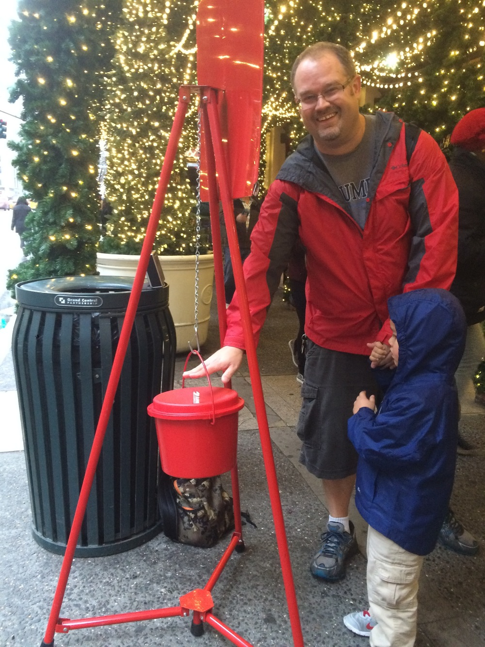 Giving money to the Salvation Army bell ringer near the 5th Ave holiday window displays.