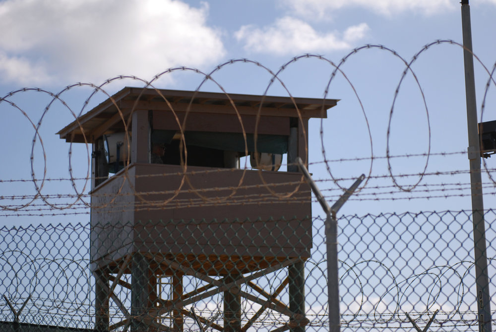 US_Navy_091231-A-0285B-005_A_Soldier_stands_guard_in_a_tower_at_Camp_Delta_at_Joint_Task_Force_Guantanamo_Bay.jpg