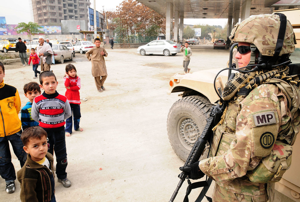 Local_soldier_mentors_Afghan_police_in_Kabul.jpg