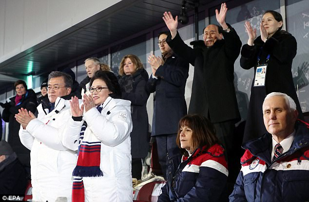 <Mike Pence defiantly sitting on the bottom right>  Photo from:  http://www.dailymail.co.uk/news/article-5375621/Pence-accused-hypocrisy-not-standing-Korea-team.html
