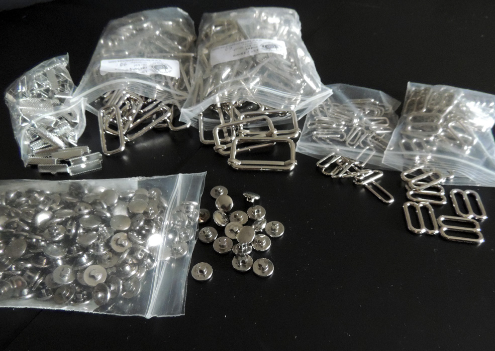 ^Lots of silver notions: Rectangle adjusters/slider thingies - these are used in the adjustable straps in both types of JSKs; ribbon crimpies - (I don't know why I find these so cute, but they are) these are of course used for the ends of the waist ties; lastly, the silver buttons used throughout the series. (I believe I also got a hella ton of headbands in this week as well, but it slipped my mind to get a picture.)