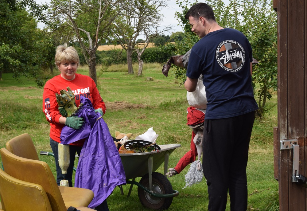 Annette and Jack clear scarecrows from the onion shed 2.JPG