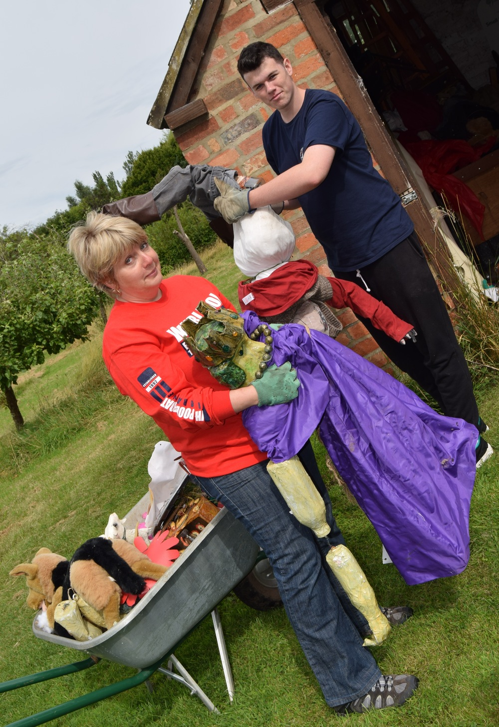 Annette and Jack clear scarecrows from the onion shed.JPG