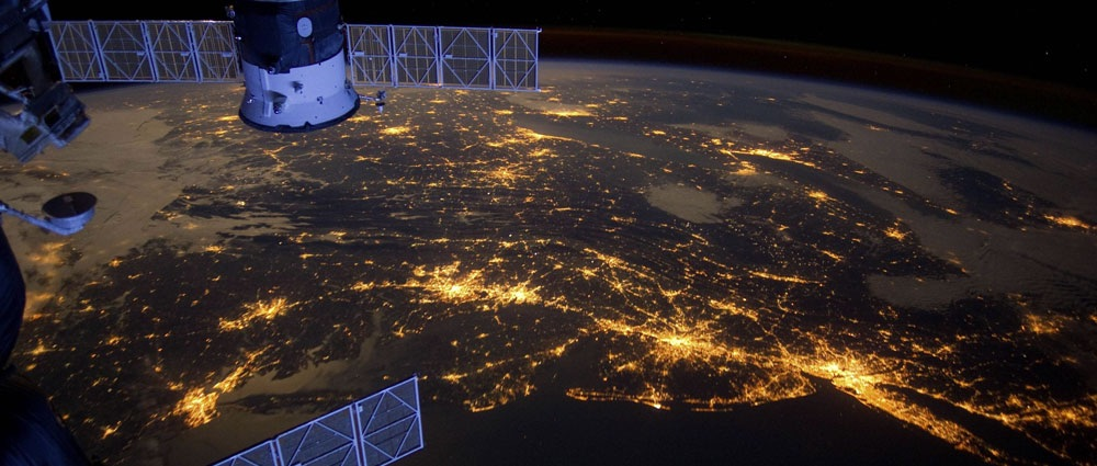 Eastern Seaboard (USA) at night –  An Expedition 30 crew member aboard the International Space Station took this nighttime photograph of much of the Atlantic coast of the United States. Large metropolitan areas and other easily recognizable sites from the Virginia/Maryland/Washington, D.C. area are visible in the image that spans almost to Rhode Island. Boston is just out of frame at right. Long Island and the New York City area are visible in the lower right quadrant. Philadelphia and Pittsburgh are near the center. Parts of two Russian vehicles parked at the orbital outpost are seen in left foreground. Image Credit: NASA