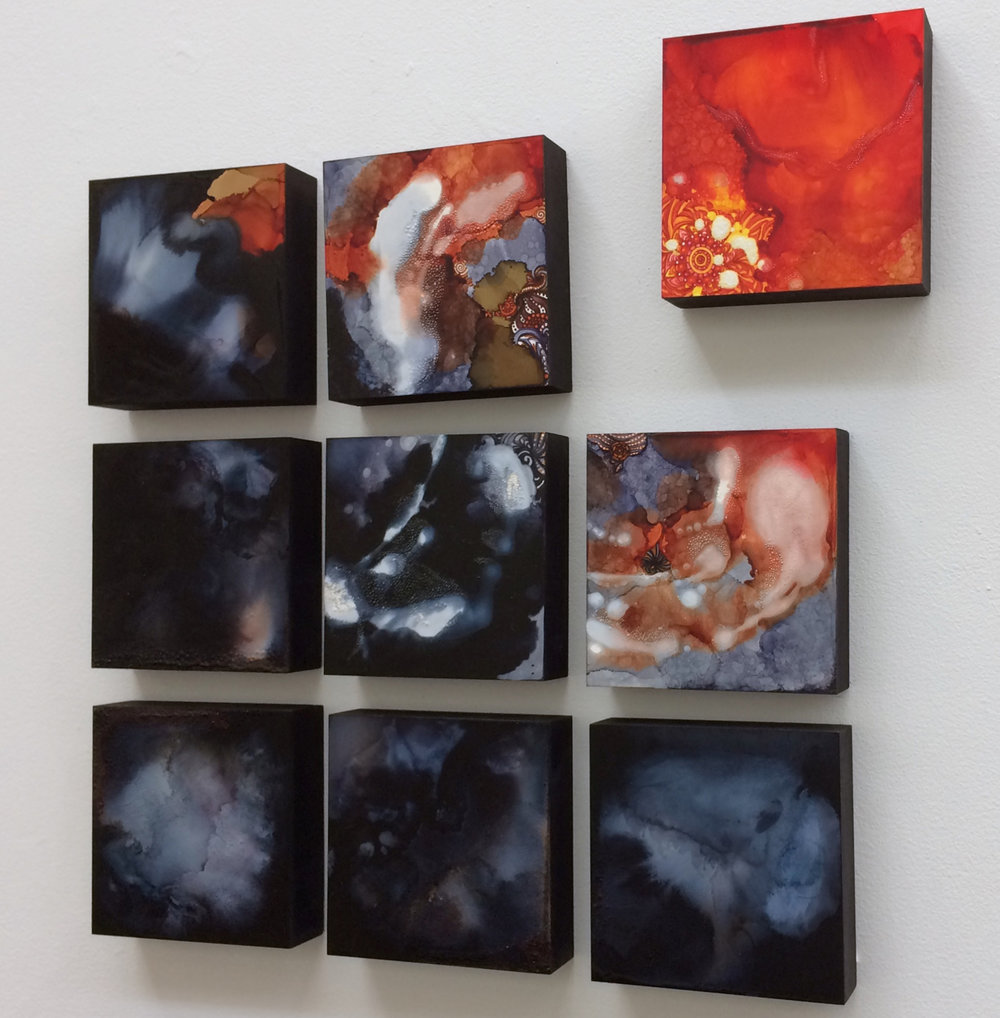 Apart - By Julia Hamilton, 2017Approximately 24 x 24 InchesMixed Media Installation: Alcohol Ink, Fire, and Felt PenMuse: Some people experience the world in a different way. We tend to assume that we are all perceiving the world in the same way, but then one realizes that their experience is different. That instant of realization is a turning point.