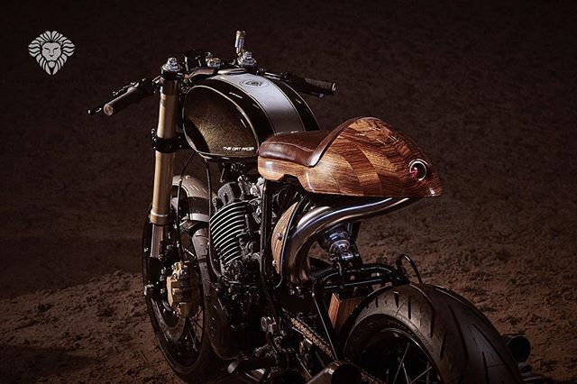 Wood on a motorcycle?! It's not a coffee table. Shaaaad up will you! Why not use wood? It's used on beautiful speed boats, inside stunning classic cars and on private jets. I'll darn well put it on my bikes if I want to thank you very much. . Beautifully captured by @tomgriffithsphotos highlighting the awesome paintwork by @blackshuckkustom. The gold speckle doesn't get seen often but under the right light......😍 . . . . #custom #wood #zebrano #handmade #motorcycle #design #bespoke #unique #woodworking #craft #expensive #yamaha #texture #material #feel #imagine #creation