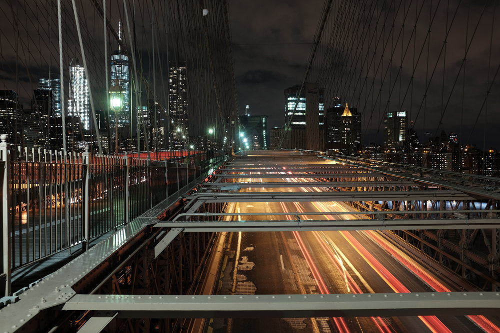 I walked the Brooklyn bridge one evening in near freezing weather, and snapped this photo of cars speeding under the bridge.